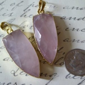 Shop Quartz Crystal Pendants! Clearance Sale..ROSE QUARTZ Dagger POINT Pendant Point Charms, 1.5 inch, Shield Shaped Point, Gold Electroplated, ap ap70.6 solo | Natural genuine Quartz pendants. Buy crystal jewelry, handmade handcrafted artisan jewelry for women.  Unique handmade gift ideas. #jewelry #beadedpendants #beadedjewelry #gift #shopping #handmadejewelry #fashion #style #product #pendants #affiliate #ad