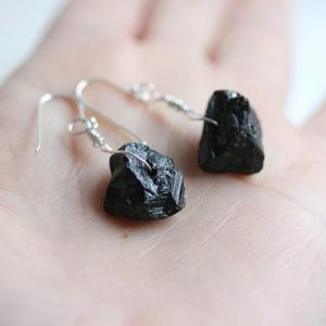 Shop Black Tourmaline Earrings! Raw black Tourmaline earrings, October birthstone, Wire wrap earrings, Dangle drop Black Earrings, Black Tourmaline Jewelry, Raw crystal | Natural genuine Black Tourmaline earrings. Buy crystal jewelry, handmade handcrafted artisan jewelry for women.  Unique handmade gift ideas. #jewelry #beadedearrings #beadedjewelry #gift #shopping #handmadejewelry #fashion #style #product #earrings #affiliate #ad