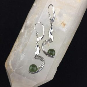 Shop Moldavite Earrings! Ribbon Dance! 7mm Spherical Moldavite Bead Nestled in Sterling Silver Rhodium Plated Ribbon Dangle Earrings | Natural genuine Moldavite earrings. Buy crystal jewelry, handmade handcrafted artisan jewelry for women.  Unique handmade gift ideas. #jewelry #beadedearrings #beadedjewelry #gift #shopping #handmadejewelry #fashion #style #product #earrings #affiliate #ad
