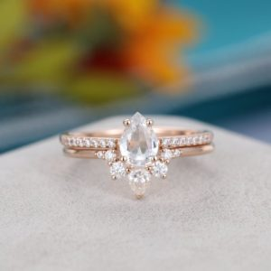 Shop Sapphire Rings! Rose gold engagement ring set vintage Pear shaped White sapphire engagement ring for women Unique wedding Bridal Anniversary gift for her | Natural genuine Sapphire rings, simple unique alternative gemstone engagement rings. #rings #jewelry #bridal #wedding #jewelryaccessories #engagementrings #weddingideas #affiliate #ad