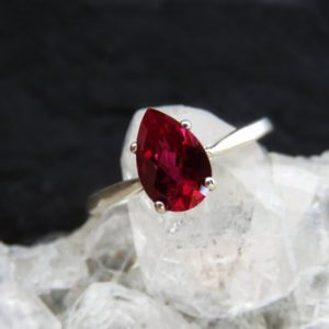 Ruby engagement ring, ruby teardrop pear solitaire engagement ring, unique red engagement rings, ruby solitaire ring, ruby teardrop ring | Natural genuine Array rings, simple unique alternative gemstone engagement rings. #rings #jewelry #bridal #wedding #jewelryaccessories #engagementrings #weddingideas #affiliate #ad
