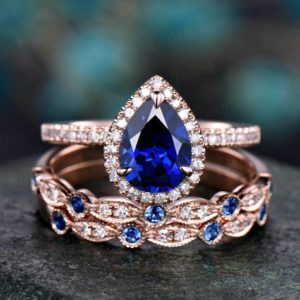 Shop Sapphire Rings! Blue sapphire engagement ring set rose gold 3pc sapphire wedding ring band vintage diamond halo ring unique marquise women bridal ring set | Natural genuine Sapphire rings, simple unique alternative gemstone engagement rings. #rings #jewelry #bridal #wedding #jewelryaccessories #engagementrings #weddingideas #affiliate #ad