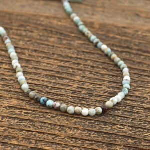 "Shop Larimar Faceted Beads! Small faceted larimar beads, 15"" strand,light blue and brown colors, round semiprecious stone, 4mm, Irina Miech 