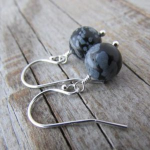 Shop Snowflake Obsidian Earrings! Snowflake Obsidian Earrings, small and simple, lightweight semi precious stone, dangle earrings | Natural genuine Snowflake Obsidian earrings. Buy crystal jewelry, handmade handcrafted artisan jewelry for women.  Unique handmade gift ideas. #jewelry #beadedearrings #beadedjewelry #gift #shopping #handmadejewelry #fashion #style #product #earrings #affiliate #ad