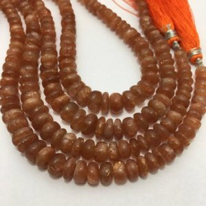 Shop Sunstone Rondelle Beads! Natural Sunstone Smooth Rondelle Beads, 9mm to 12mm, 8 inches, Orange Beads, Gemstone Beads, Semiprecious Stone Beads | Natural genuine rondelle Sunstone beads for beading and jewelry making.  #jewelry #beads #beadedjewelry #diyjewelry #jewelrymaking #beadstore #beading #affiliate #ad