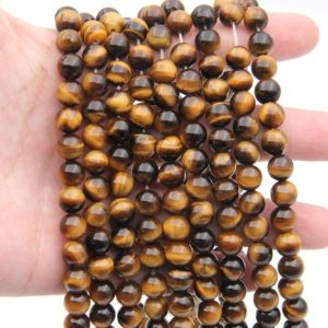 Shop Tiger Eye Round Beads! Natural Yellow Tiger Eyes Stone Beads,4mm 6mm 8mm 10mm 12mm Round Gemtone Beads,High Quality Stone Beads,Gemstone Loose Beads Wholesale. | Natural genuine round Tiger Eye beads for beading and jewelry making.  #jewelry #beads #beadedjewelry #diyjewelry #jewelrymaking #beadstore #beading #affiliate #ad