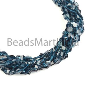 Shop Topaz Beads! London Blue Topaz Faceted Nugget Shape Beads, blue Topaz Nugget Shape Beads, london Blue Topaz Faceted Beads, london Blue Topaz Beads | Natural genuine beads Topaz beads for beading and jewelry making.  #jewelry #beads #beadedjewelry #diyjewelry #jewelrymaking #beadstore #beading #affiliate #ad
