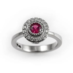 Unique ruby engagement ring, natural ruby ring, diamond halo ring with ruby, natural red ruby ring, ruby and diamond ring, white gold ring | Natural genuine Array rings, simple unique alternative gemstone engagement rings. #rings #jewelry #bridal #wedding #jewelryaccessories #engagementrings #weddingideas #affiliate #ad