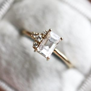 Shop Sapphire Rings! White Sapphire Engagement Ring, White Baguette Diamond Engagement Ring, White Sapphire Ring with Diamonds, Cluster Engagement Ring | Natural genuine Sapphire rings, simple unique alternative gemstone engagement rings. #rings #jewelry #bridal #wedding #jewelryaccessories #engagementrings #weddingideas #affiliate #ad