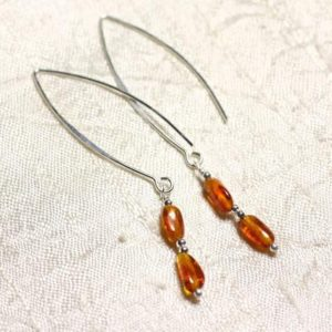 Shop Amber Earrings! Amber and Silver 925 long hooks earrings natural Olives 7-8mm | Natural genuine Amber earrings. Buy crystal jewelry, handmade handcrafted artisan jewelry for women.  Unique handmade gift ideas. #jewelry #beadedearrings #beadedjewelry #gift #shopping #handmadejewelry #fashion #style #product #earrings #affiliate #ad