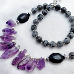 Long amethyst statement necklace with larvikite. Purple, gray & black crystal gemstone shard jewelry. February birthstone. | Natural genuine Gemstone necklaces. Buy crystal jewelry, handmade handcrafted artisan jewelry for women.  Unique handmade gift ideas. #jewelry #beadednecklaces #beadedjewelry #gift #shopping #handmadejewelry #fashion #style #product #necklaces #affiliate #ad