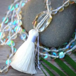 Shop Angel Aura Quartz Necklaces! Mystic Rainbow Angel Aura Mermaid 8mm 108 Bead Hand Knotted Large Faceted Clear Quartz Guru White Tassel Meditation Crystal Necklace | Natural genuine Angel Aura Quartz necklaces. Buy crystal jewelry, handmade handcrafted artisan jewelry for women.  Unique handmade gift ideas. #jewelry #beadednecklaces #beadedjewelry #gift #shopping #handmadejewelry #fashion #style #product #necklaces #affiliate #ad