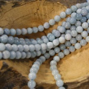Shop Aquamarine Round Beads! Aquamarine Smooth Round Natural 4mm 5mm 8mm 10mm Gemstone Bead-15.5 inch strand- | Natural genuine round Aquamarine beads for beading and jewelry making.  #jewelry #beads #beadedjewelry #diyjewelry #jewelrymaking #beadstore #beading #affiliate #ad