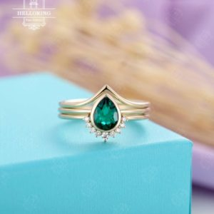 Pear Shaped Emerald Engagement Ring set Yellow gold diamond wedding band bezel set Birthstone bridal set  Anniversary | Natural genuine Gemstone rings, simple unique alternative gemstone engagement rings. #rings #jewelry #bridal #wedding #jewelryaccessories #engagementrings #weddingideas #affiliate #ad