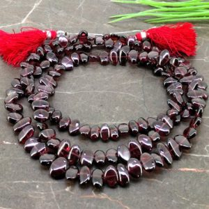 Shop Garnet Chip & Nugget Beads! Natural Garnet 7.5-11mm Smooth Nuggets Gemstone Beads / Approx 134 Pieces on 32 Inch Long Strand / JBC-ET-154911 | Natural genuine chip Garnet beads for beading and jewelry making.  #jewelry #beads #beadedjewelry #diyjewelry #jewelrymaking #beadstore #beading #affiliate #ad