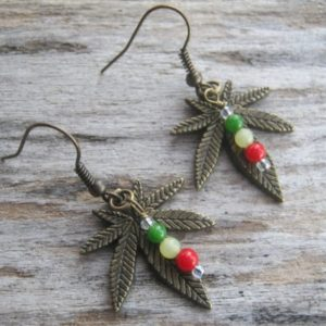 Shop Jade Earrings! Rasta Pot Leaf Earrings, BRONZE, Jade Cannabis Earrings, Marijuana Earrings, Rasta Jewelry, Rastafarian, Red Gold & Green Earrings, 420 | Natural genuine Jade earrings. Buy crystal jewelry, handmade handcrafted artisan jewelry for women.  Unique handmade gift ideas. #jewelry #beadedearrings #beadedjewelry #gift #shopping #handmadejewelry #fashion #style #product #earrings #affiliate #ad