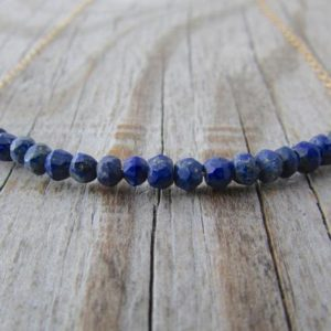 Shop Lapis Lazuli Necklaces! Lapis Necklace, small, faceted, blue lapis lazuli, gemstone rondelle, necklace with gold | Natural genuine Lapis Lazuli necklaces. Buy crystal jewelry, handmade handcrafted artisan jewelry for women.  Unique handmade gift ideas. #jewelry #beadednecklaces #beadedjewelry #gift #shopping #handmadejewelry #fashion #style #product #necklaces #affiliate #ad