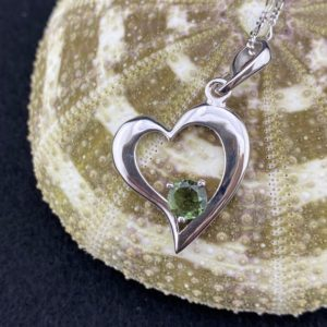 Shop Moldavite Stones & Crystals! Round Faceted 6mm Moldavite Cradled in a Sterling Silver Rhodium Plated Heart | Natural genuine stones & crystals in various shapes & sizes. Buy raw cut, tumbled, or polished gemstones for making jewelry or crystal healing energy vibration raising reiki stones. #crystals #gemstones #crystalhealing #crystalsandgemstones #energyhealing #affiliate #ad