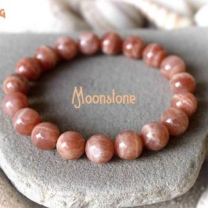 Shop Moonstone Bracelets! 10mm Moonstone Bracelet, Orange Moonstone Bracelet, Fertility Bracelet, Conceive Jewelry, Healing Bracelet, Pregnancy Bracelet, Childbirth | Natural genuine Moonstone bracelets. Buy crystal jewelry, handmade handcrafted artisan jewelry for women.  Unique handmade gift ideas. #jewelry #beadedbracelets #beadedjewelry #gift #shopping #handmadejewelry #fashion #style #product #bracelets #affiliate #ad