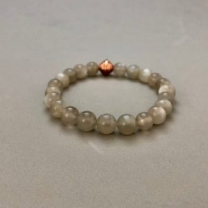 Shop Moonstone Bracelets! 8MM Gray Moonstone Stretch Bead Bracelet with Copper Accent Bead | Natural genuine Moonstone bracelets. Buy crystal jewelry, handmade handcrafted artisan jewelry for women.  Unique handmade gift ideas. #jewelry #beadedbracelets #beadedjewelry #gift #shopping #handmadejewelry #fashion #style #product #bracelets #affiliate #ad