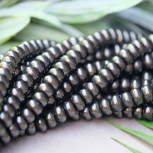 Shop Shungite Beads! Natural Shungite Rondelle Beads, 5x8mm, 15.5 Inches, Full Strand | Natural genuine rondelle Shungite beads for beading and jewelry making.  #jewelry #beads #beadedjewelry #diyjewelry #jewelrymaking #beadstore #beading #affiliate #ad