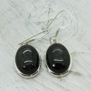 Shop Obsidian Earrings! Oval Black Obsidian stone with some golden sheen earrings sterling silver 925 silver earrings natural Black Obsidian stone jewelry gift | Natural genuine Obsidian earrings. Buy crystal jewelry, handmade handcrafted artisan jewelry for women.  Unique handmade gift ideas. #jewelry #beadedearrings #beadedjewelry #gift #shopping #handmadejewelry #fashion #style #product #earrings #affiliate #ad