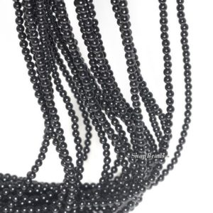 Shop Onyx Round Beads! 2mm Noir Black Onyx Gemstone Round 2mm Loose Beads 16 inch Full Strand (90113994-107 – 2mm A) | Natural genuine round Onyx beads for beading and jewelry making.  #jewelry #beads #beadedjewelry #diyjewelry #jewelrymaking #beadstore #beading #affiliate #ad