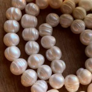 Shop Pearl Bead Shapes! Freshwater Rustic Ivory Pearl beads Natural 6mm / Pearl Beads / Wedding Jewellery Beads / Mala beads Oval Potato | Natural genuine other-shape Pearl beads for beading and jewelry making.  #jewelry #beads #beadedjewelry #diyjewelry #jewelrymaking #beadstore #beading #affiliate #ad