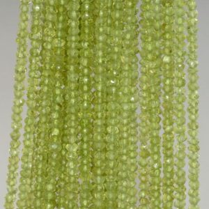 Shop Peridot Faceted Beads! 4×3-3x2mm Peridot Gemstone Green Grade AAA Faceted Rondelle Loose Beads 13 inch Full Strand (90184337-852) | Natural genuine faceted Peridot beads for beading and jewelry making.  #jewelry #beads #beadedjewelry #diyjewelry #jewelrymaking #beadstore #beading #affiliate #ad