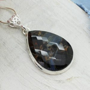 Shop Pietersite Pendants! Amazing Faceted pietersite pendant teardrop shape faceted cut stone blue pietersite set on sterling silver 925 unisex pendant all natural | Natural genuine Pietersite pendants. Buy crystal jewelry, handmade handcrafted artisan jewelry for women.  Unique handmade gift ideas. #jewelry #beadedpendants #beadedjewelry #gift #shopping #handmadejewelry #fashion #style #product #pendants #affiliate #ad