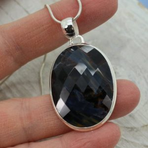 Shop Pietersite Pendants! Pietersite pendant oval shape faceted cut stone blue pietersite set on sterling silver 925 unisex pendant all natural | Natural genuine Pietersite pendants. Buy crystal jewelry, handmade handcrafted artisan jewelry for women.  Unique handmade gift ideas. #jewelry #beadedpendants #beadedjewelry #gift #shopping #handmadejewelry #fashion #style #product #pendants #affiliate #ad