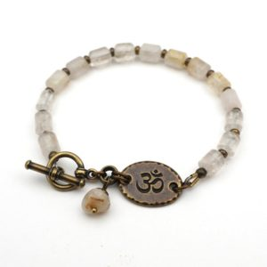 Shop Quartz Crystal Bracelets! Brass Tibetan om bracelet, quartz zen jewelry, semiprecious stone, 7 3/4 inches long | Natural genuine Quartz bracelets. Buy crystal jewelry, handmade handcrafted artisan jewelry for women.  Unique handmade gift ideas. #jewelry #beadedbracelets #beadedjewelry #gift #shopping #handmadejewelry #fashion #style #product #bracelets #affiliate #ad