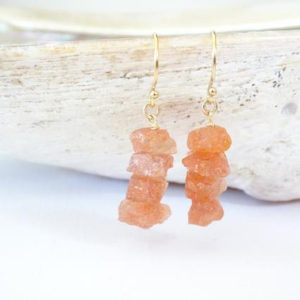 Shop Sunstone Earrings! Raw Sunstone Natural Gemstone Earrings with Genuine Rough Crystals, Orange Stone Jewelry Healing Chakra Gift, Earrings for women, Birthday | Natural genuine Sunstone earrings. Buy crystal jewelry, handmade handcrafted artisan jewelry for women.  Unique handmade gift ideas. #jewelry #beadedearrings #beadedjewelry #gift #shopping #handmadejewelry #fashion #style #product #earrings #affiliate #ad