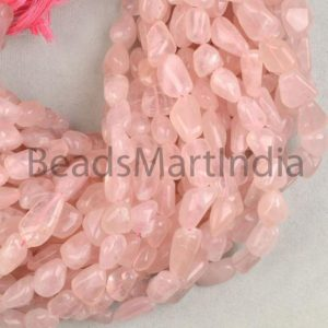 Shop Rose Quartz Chip & Nugget Beads! Rose Quartz Plain Nugget Shape Natural Beads, Natural Smooth Beads, Plain Nugget Beads, Rose Quartz Smooth Beads, rose Quartz Wholesale Beads | Natural genuine chip Rose Quartz beads for beading and jewelry making.  #jewelry #beads #beadedjewelry #diyjewelry #jewelrymaking #beadstore #beading #affiliate #ad