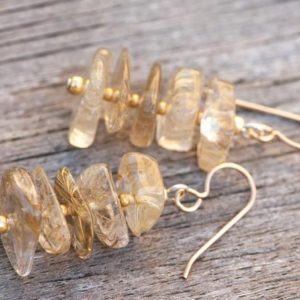 Shop Rutilated Quartz Earrings! Golden Rutilated Quartz Earrings, Golden Earrings, Natural Stone Earrings, Funky Earrings, Chunky Earrings, Rustic Earrings, Healing Stones | Natural genuine Rutilated Quartz earrings. Buy crystal jewelry, handmade handcrafted artisan jewelry for women.  Unique handmade gift ideas. #jewelry #beadedearrings #beadedjewelry #gift #shopping #handmadejewelry #fashion #style #product #earrings #affiliate #ad