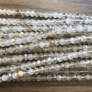 Shop Rutilated Quartz Faceted Beads! Natural Rutilated Quartz 5x4mm faceted Rondelle Gemstone Beads –15.5 inch strand 1 strand/3 strands | Natural genuine faceted Rutilated Quartz beads for beading and jewelry making.  #jewelry #beads #beadedjewelry #diyjewelry #jewelrymaking #beadstore #beading #affiliate #ad
