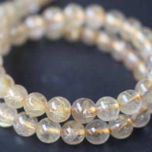 Shop Rutilated Quartz Round Beads! Natural AAA Gold Rutile Quartz Round Beads,6mm/8mm/10mm/12mm/ Rutile Quartz Beads,15 inches one starand | Natural genuine round Rutilated Quartz beads for beading and jewelry making.  #jewelry #beads #beadedjewelry #diyjewelry #jewelrymaking #beadstore #beading #affiliate #ad