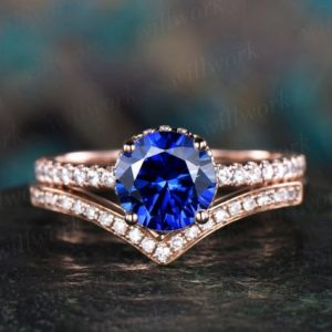 2pcs blue sapphire ring vintage sapphire engagement ring set rose gold for women under moissanite halo September birthstone brdial ring set | Natural genuine Array rings, simple unique alternative gemstone engagement rings. #rings #jewelry #bridal #wedding #jewelryaccessories #engagementrings #weddingideas #affiliate #ad