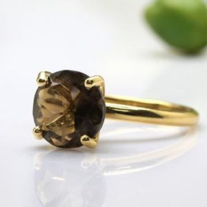Shop Smoky Quartz Jewelry! delicate gold ring,smoky quartz ring,round gemstone ring,brown stone ring,stone stacking ring | Natural genuine Smoky Quartz jewelry. Buy crystal jewelry, handmade handcrafted artisan jewelry for women.  Unique handmade gift ideas. #jewelry #beadedjewelry #beadedjewelry #gift #shopping #handmadejewelry #fashion #style #product #jewelry #affiliate #ad