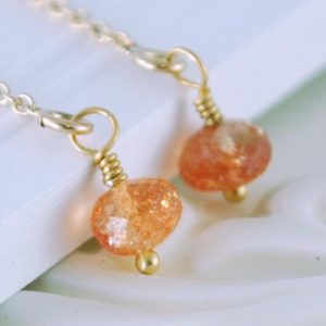 Shop Sunstone Earrings! Sunstone Earrings, Gemstone Threaders, Simple and Delicate, Sterling Silver or Gold Jewelry, Gold Threader Earrings, Made to Order | Natural genuine Sunstone earrings. Buy crystal jewelry, handmade handcrafted artisan jewelry for women.  Unique handmade gift ideas. #jewelry #beadedearrings #beadedjewelry #gift #shopping #handmadejewelry #fashion #style #product #earrings #affiliate #ad