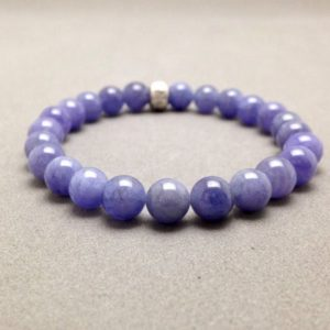 Shop Tanzanite Bracelets! Tanzanite Stretch Bead Bracelet with Karen Hill Tribe Om Accent Bead | Natural genuine Tanzanite bracelets. Buy crystal jewelry, handmade handcrafted artisan jewelry for women.  Unique handmade gift ideas. #jewelry #beadedbracelets #beadedjewelry #gift #shopping #handmadejewelry #fashion #style #product #bracelets #affiliate #ad