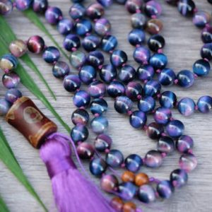 Shop Tiger Eye Jewelry! Purple Pink Blue Tigers Eye 8mm Dzi Tibetan Guru 108 Hand-knotted Mala Purple Silk Tassel Galaxy Tigers Eye | Natural genuine Tiger Eye jewelry. Buy crystal jewelry, handmade handcrafted artisan jewelry for women.  Unique handmade gift ideas. #jewelry #beadedjewelry #beadedjewelry #gift #shopping #handmadejewelry #fashion #style #product #jewelry #affiliate #ad