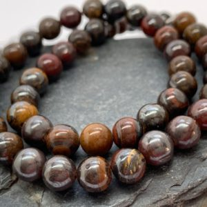 Shop Tiger Eye Round Beads! Tigers Iron Round Beads Tigers Eye Gemstone 8mm | Natural genuine round Tiger Eye beads for beading and jewelry making.  #jewelry #beads #beadedjewelry #diyjewelry #jewelrymaking #beadstore #beading #affiliate #ad