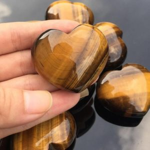 Shop Tiger Eye Shapes! Tiger Eye Heart Stone 40mm for Reiki Healing and Chakra Healing | Natural genuine stones & crystals in various shapes & sizes. Buy raw cut, tumbled, or polished gemstones for making jewelry or crystal healing energy vibration raising reiki stones. #crystals #gemstones #crystalhealing #crystalsandgemstones #energyhealing #affiliate #ad