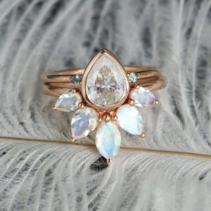 Pear shaped moissanite engagement ring set Rose gold,Marquise cut moonstone wedding band, London Blue Topaz Jewelry, Unique Gift for her | Natural genuine Gemstone rings, simple unique alternative gemstone engagement rings. #rings #jewelry #bridal #wedding #jewelryaccessories #engagementrings #weddingideas #affiliate #ad
