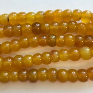 Shop Agate Rondelle Beads! Yellow Agate 12x8mm Rondelle Gemstone Bead-~ -7.5 inch strand | Natural genuine rondelle Agate beads for beading and jewelry making.  #jewelry #beads #beadedjewelry #diyjewelry #jewelrymaking #beadstore #beading #affiliate #ad