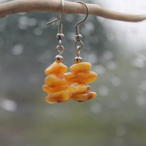 Shop Amber Earrings! Raw Unpolished Baltic Amber Earrings Dangle Rough Stone Jewelry Natural Eco Orange Yellow Butterscotch | Natural genuine Amber earrings. Buy crystal jewelry, handmade handcrafted artisan jewelry for women.  Unique handmade gift ideas. #jewelry #beadedearrings #beadedjewelry #gift #shopping #handmadejewelry #fashion #style #product #earrings #affiliate #ad