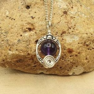 Shop Amethyst Pendants! Small Amethyst Pendant. Purple Reiki jewelry uk. February birthstone necklace. Wire wrapped pendant. Oval frame necklace. 10mm stone | Natural genuine Amethyst pendants. Buy crystal jewelry, handmade handcrafted artisan jewelry for women.  Unique handmade gift ideas. #jewelry #beadedpendants #beadedjewelry #gift #shopping #handmadejewelry #fashion #style #product #pendants #affiliate #ad