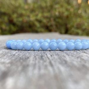 Shop Angelite Bracelets! Dainty Angelite Beaded Bracelet 6mm Anhydrite Beaded Gemstone Bracelet Stack Bracelet Beaded Gift Bracelet Healing & Protection Bracelet | Natural genuine Angelite bracelets. Buy crystal jewelry, handmade handcrafted artisan jewelry for women.  Unique handmade gift ideas. #jewelry #beadedbracelets #beadedjewelry #gift #shopping #handmadejewelry #fashion #style #product #bracelets #affiliate #ad