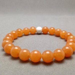 Shop Aventurine Bracelets! Orange Red Aventurine Stretch Bead Bracelet with Sterling Silver Accent Bead | Natural genuine Aventurine bracelets. Buy crystal jewelry, handmade handcrafted artisan jewelry for women.  Unique handmade gift ideas. #jewelry #beadedbracelets #beadedjewelry #gift #shopping #handmadejewelry #fashion #style #product #bracelets #affiliate #ad